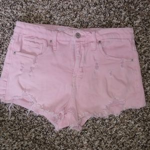High-waisted pink distressed shorts